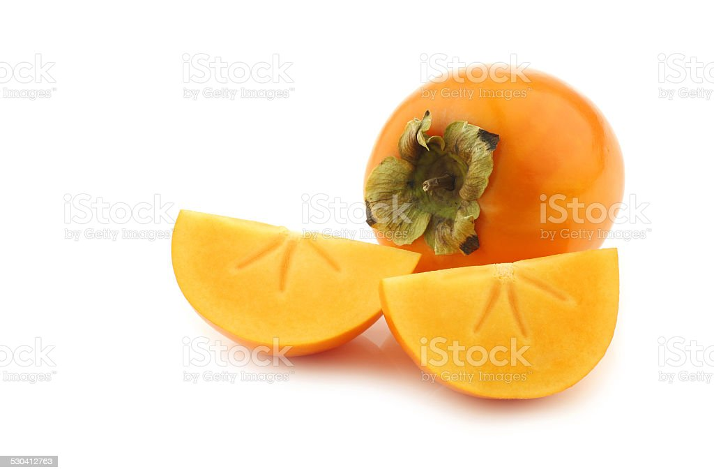 fresh kaki fruit and some cut pieces stock photo