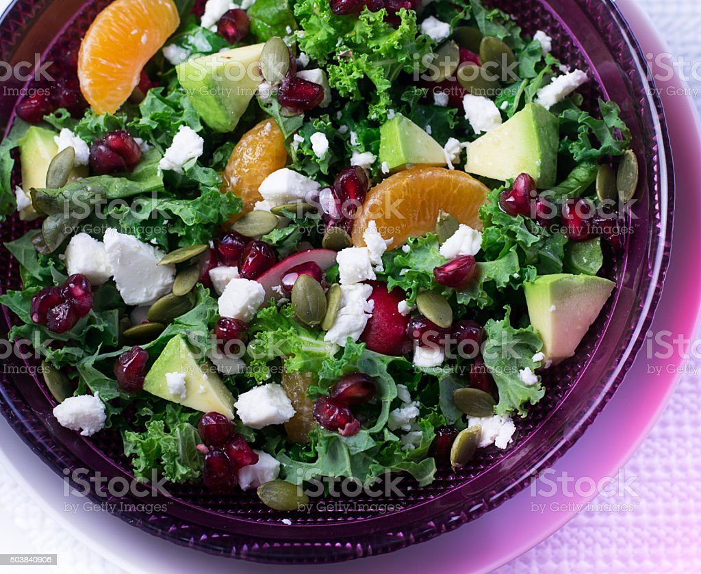 fresh kale salad with fruits and feta cheese stock photo