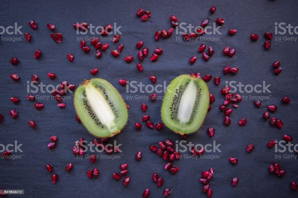 Fresh kiwi halves on a black background stock photo
