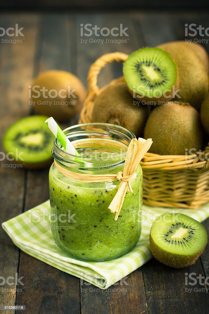 Fresh kiwi smoothie and fruit on the table stock photo