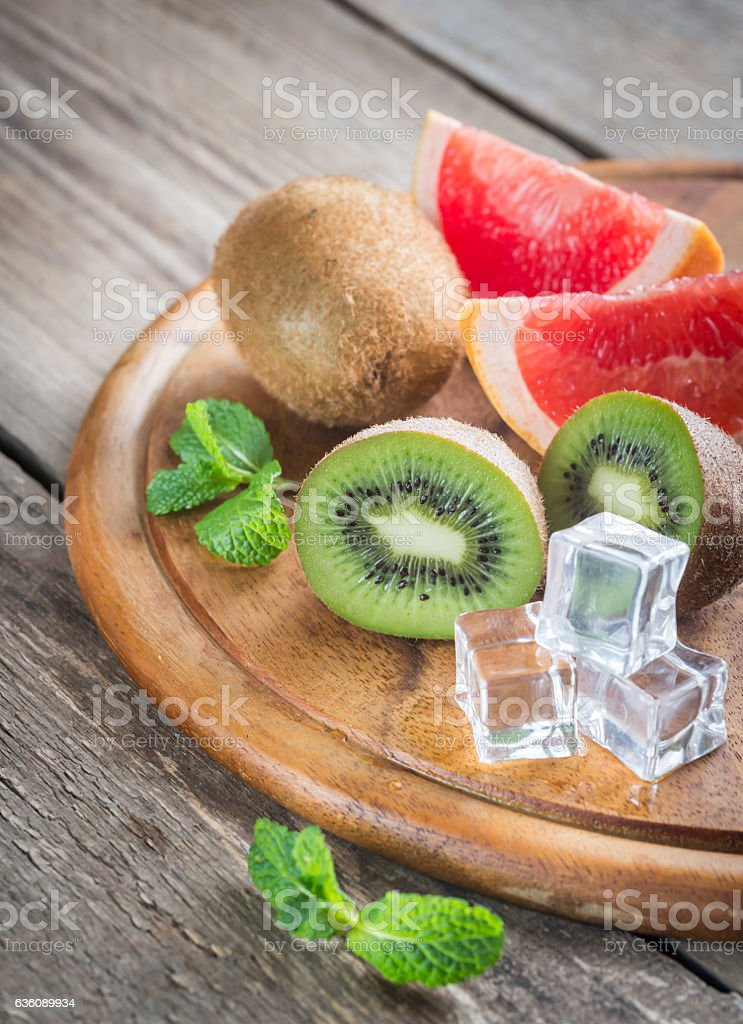 Fresh kiwifruits and grapefruit stock photo