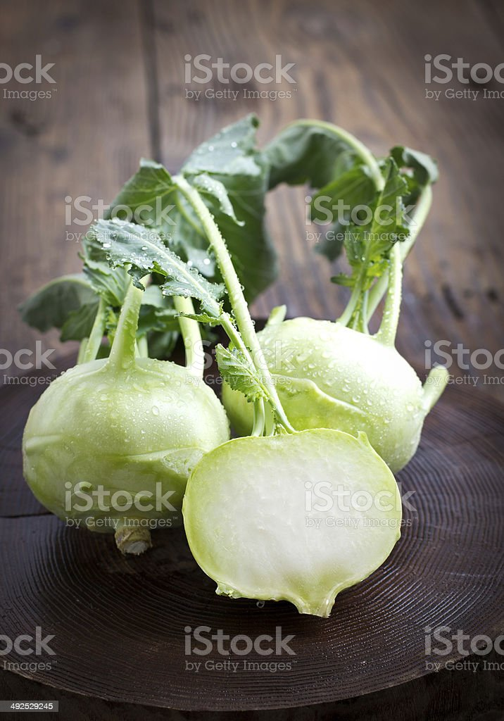 Fresh kohlrabi on the wooden table closeup stock photo