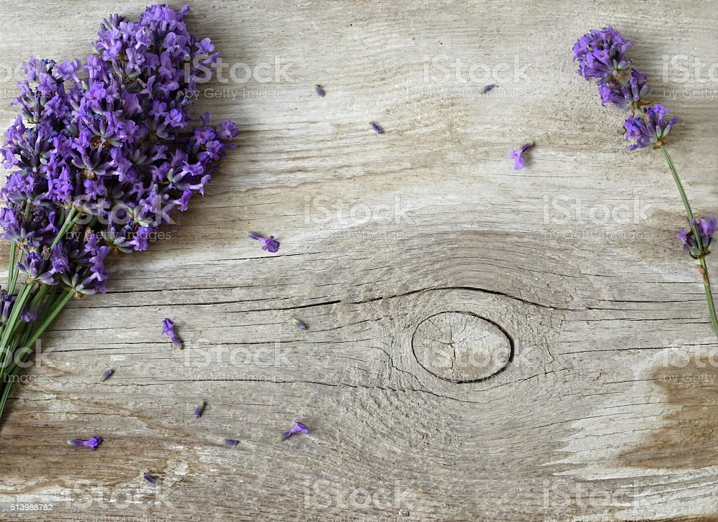 Fresh lavender flowers on a wooden background. Photo from above. stock photo
