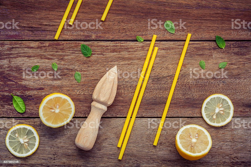 Fresh lemon and wooden juicer for summer juice and cocktail. stock photo