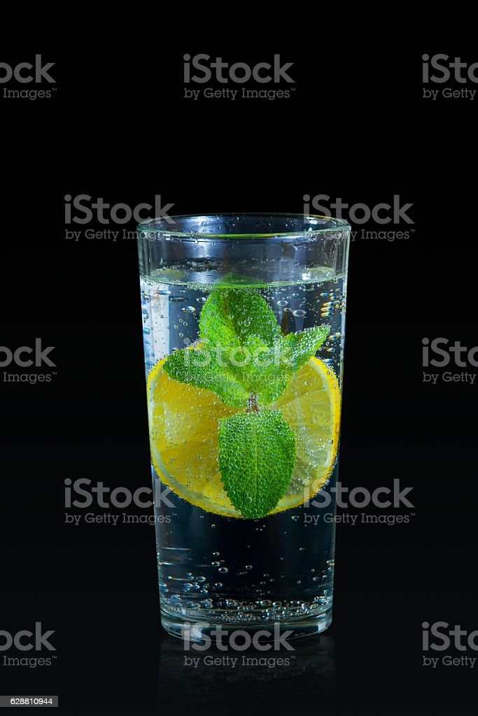 Fresh lemon drink with mint on the black background royalty-free stock photo