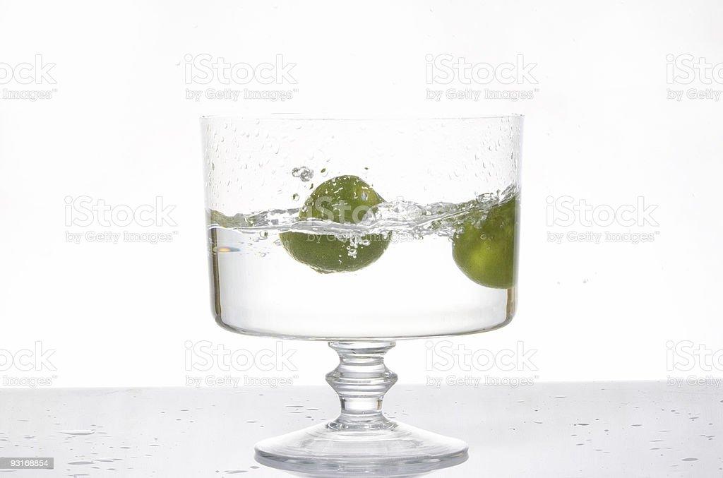 Fresh lemon splash into water royalty-free stock photo