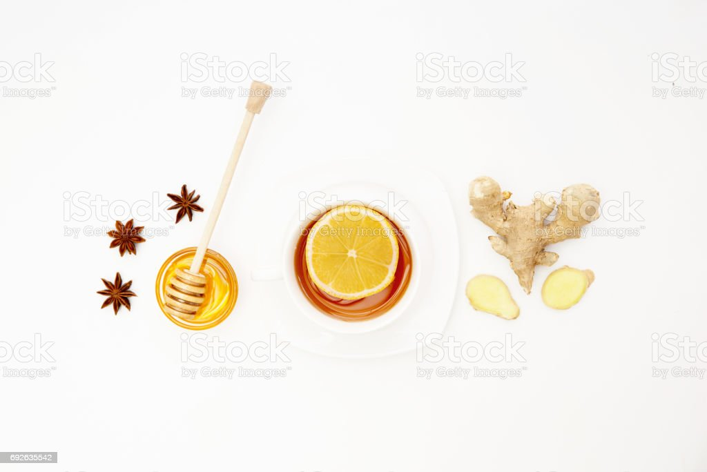 Fresh Lemon Tea with Ginger on white Background. Natural Cold Remedy. Flat lay, top view, copy space stock photo