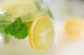fresh lemonade with lemon and peppermint leaf in jug