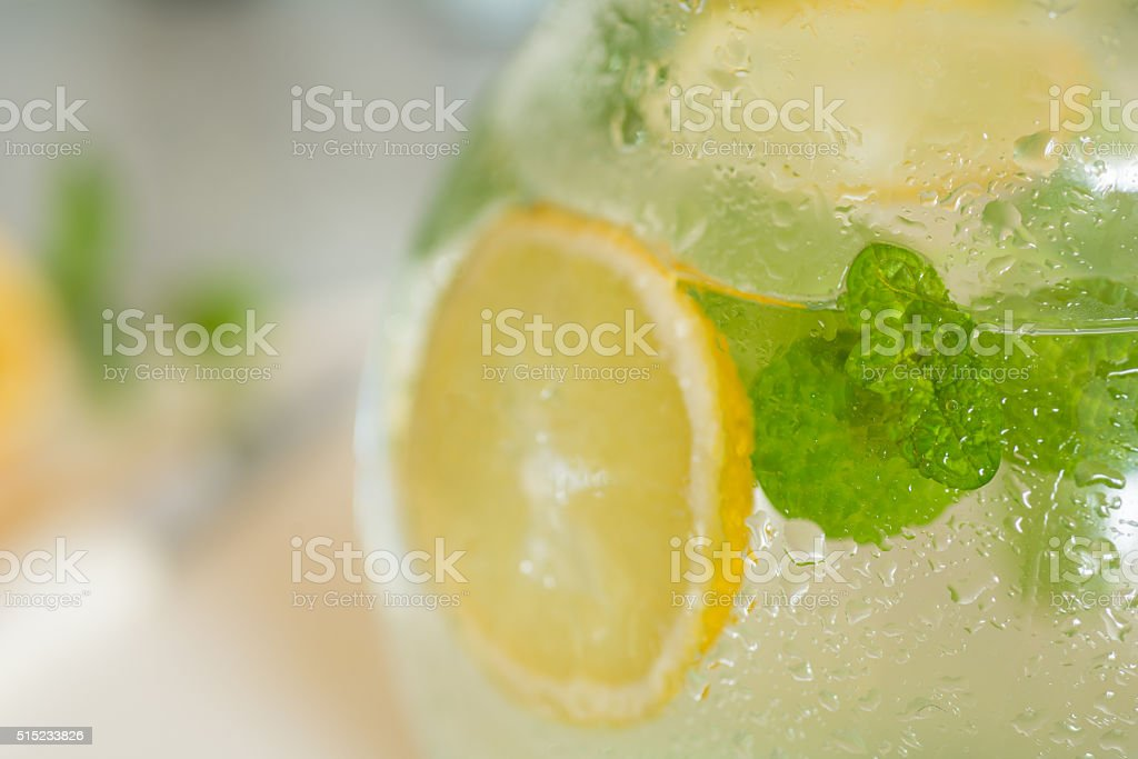 fresh lemonade with lemon and peppermint leaf in jug stock photo