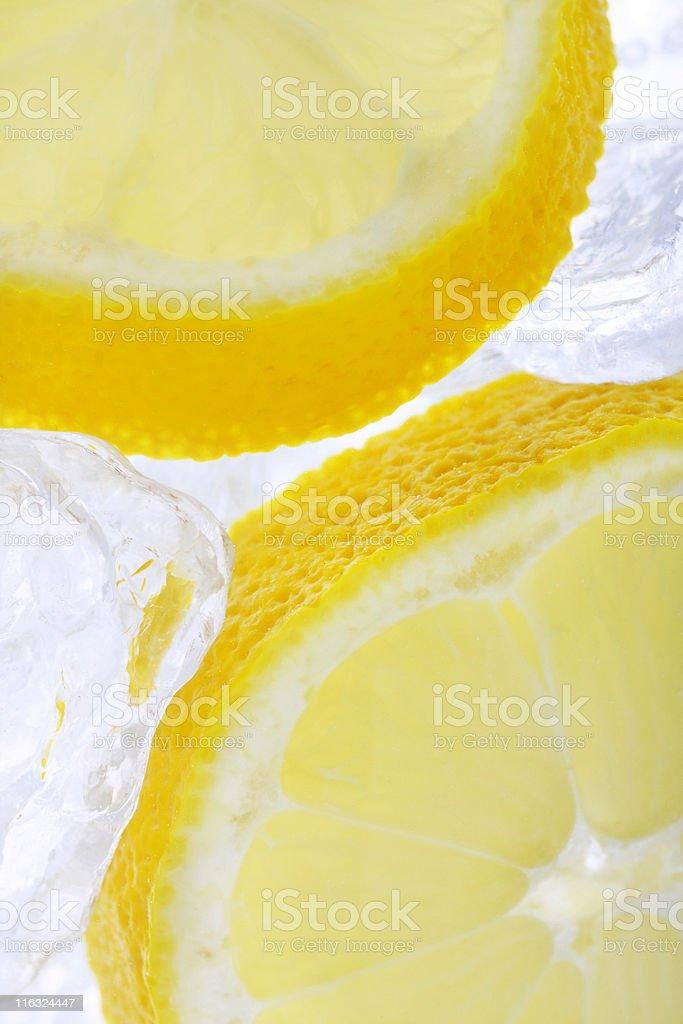 fresh lemons on ice stock photo