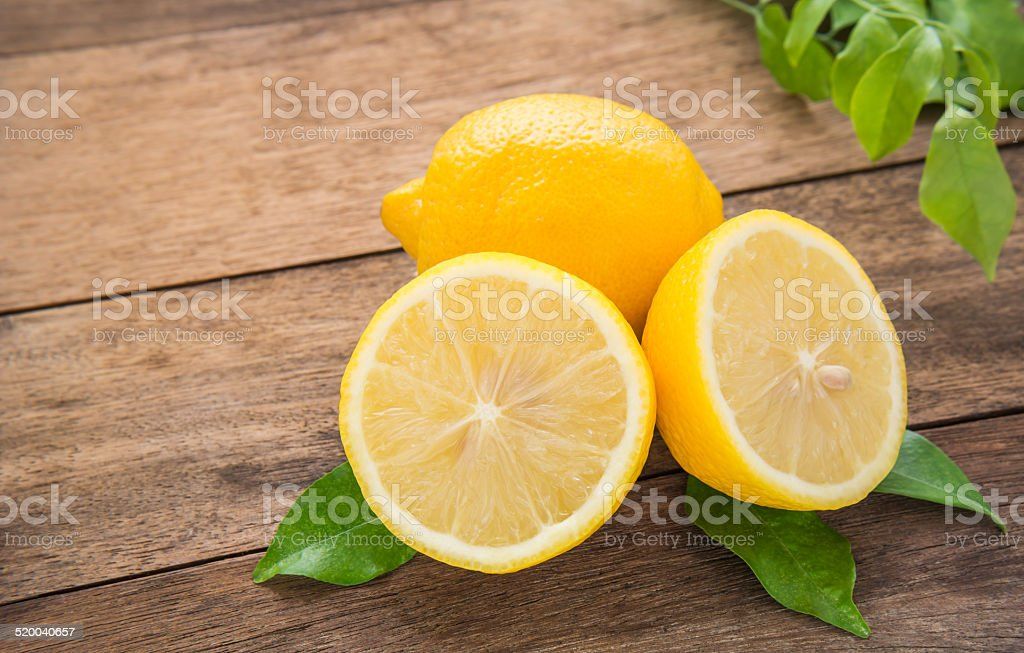 Fresh lemons on wooden table stock photo