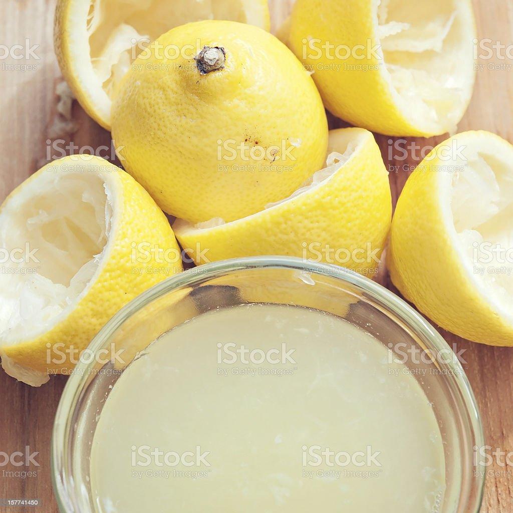 Fresh Lemons with Lemon Juice stock photo