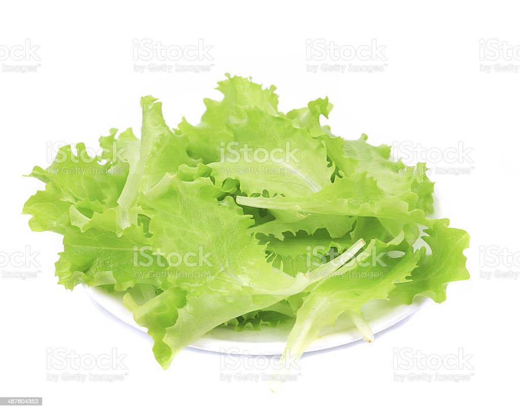 Fresh lettuce on plate close up. royalty-free stock photo