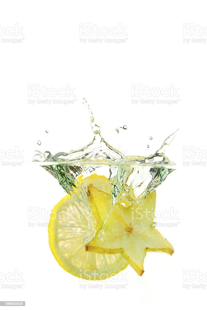 Fresh lime and star fruit water splash royalty-free stock photo