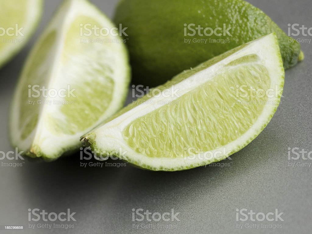 Fresh lime slices on steel countertop royalty-free stock photo