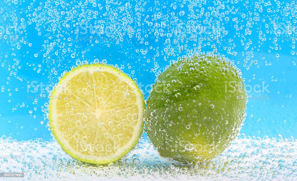 fresh lime water bubbles stock photo