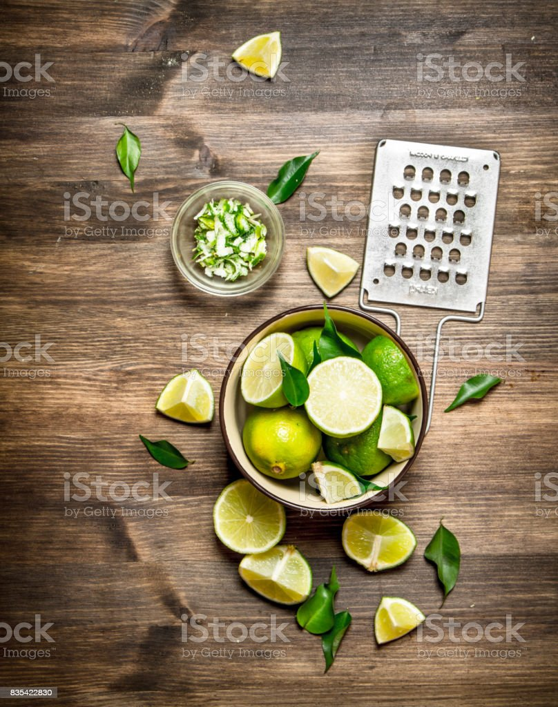 Fresh limes with grater and zest. stock photo