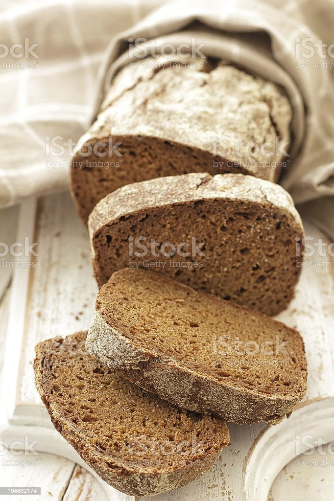 A fresh loaf of bread cut into slices  stock photo