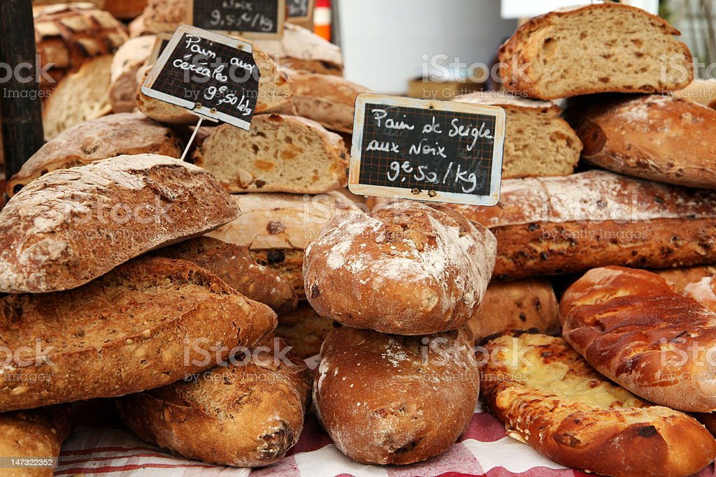 Fresh loaves of french bread on market stall in Provence royalty-free stock photo