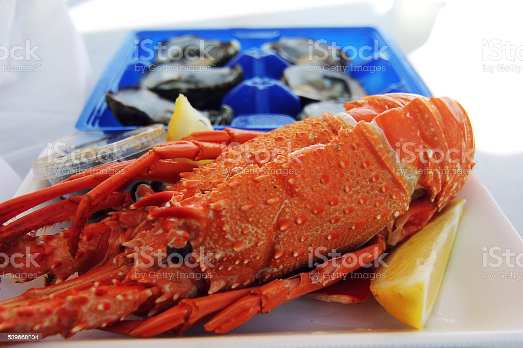 fresh lobster and oyster with lemon at sydney fish market stock photo