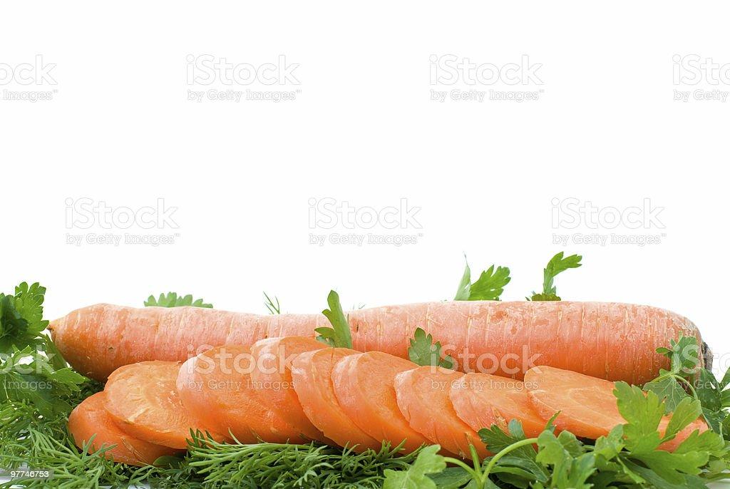 long Cenoura fresca e fatias sobre alguns Salsa foto de stock royalty-free