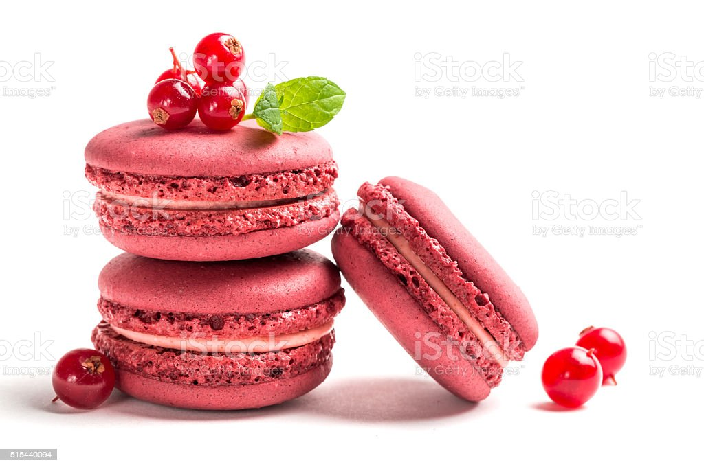 Fresh macaroons with red currant on white background stock photo