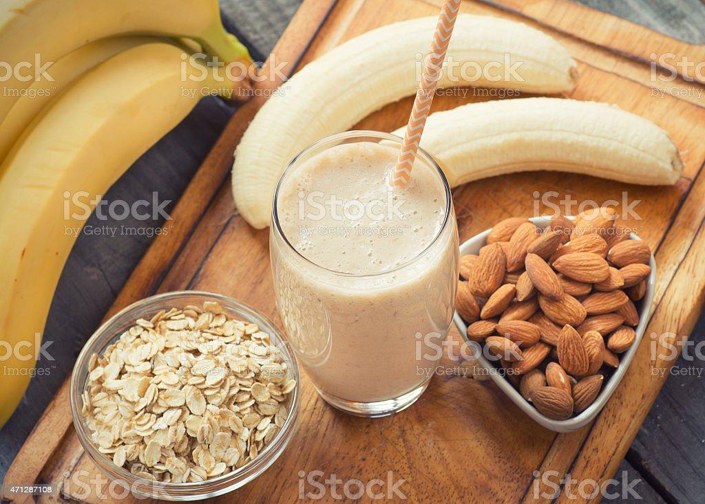 Fresh made Banana smoothie on wooden background stock photo