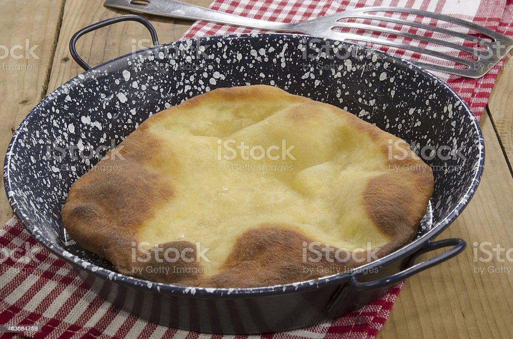 fresh made hungarian langos in a pan stock photo