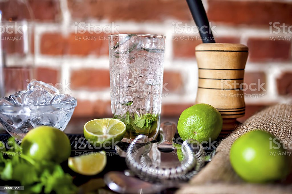 fresh made mint mojito cocktail drink with ingredients at bar stock photo