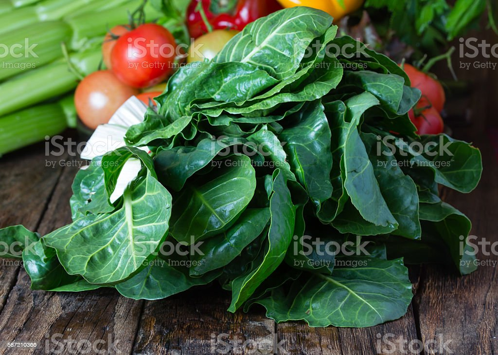 Fresh mangold and vegetables on wooden rustic background stock photo