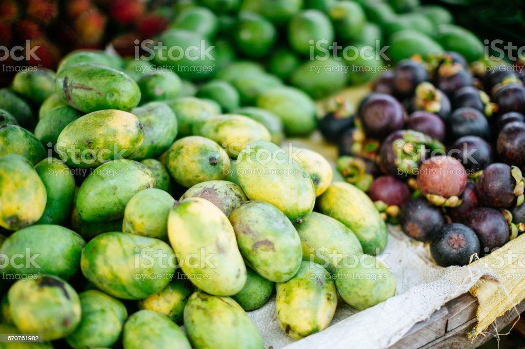 Fresh mangosteen and mangos stock photo