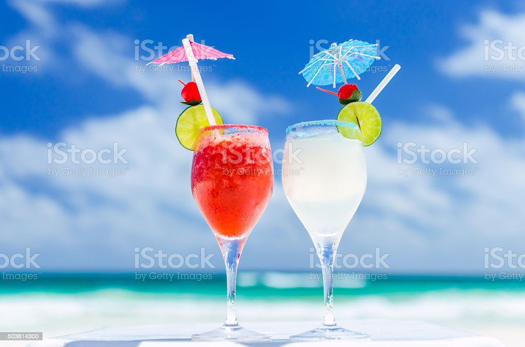 Fresh Margarita cocktails against tropical turquoise sea in the Caribbean stock photo