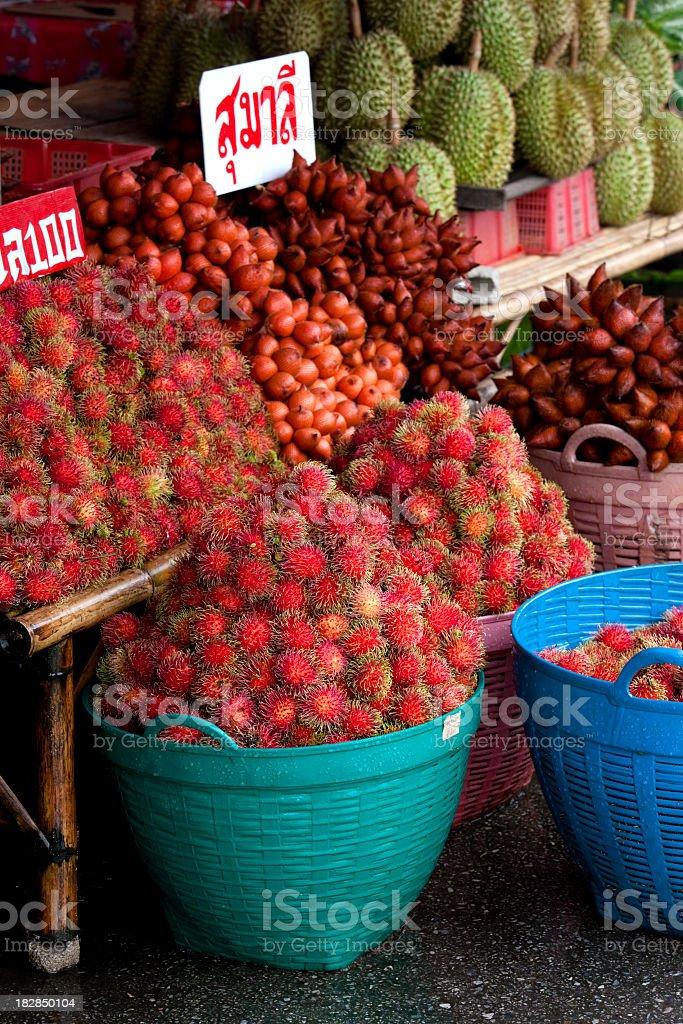 Fresh market Thai tropical fruit for sale. stock photo
