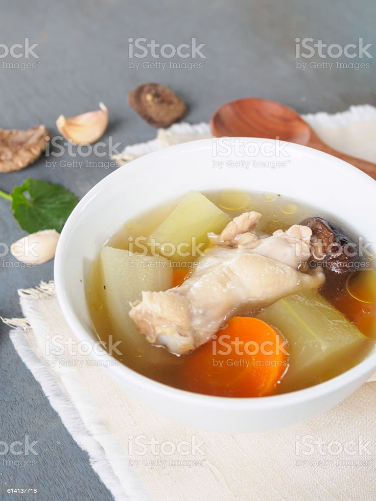Fresh marrow squash  soup in white bowl on wooden table stock photo