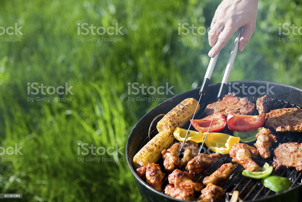 Fresh meat and vegetables on outdoor grill stock photo