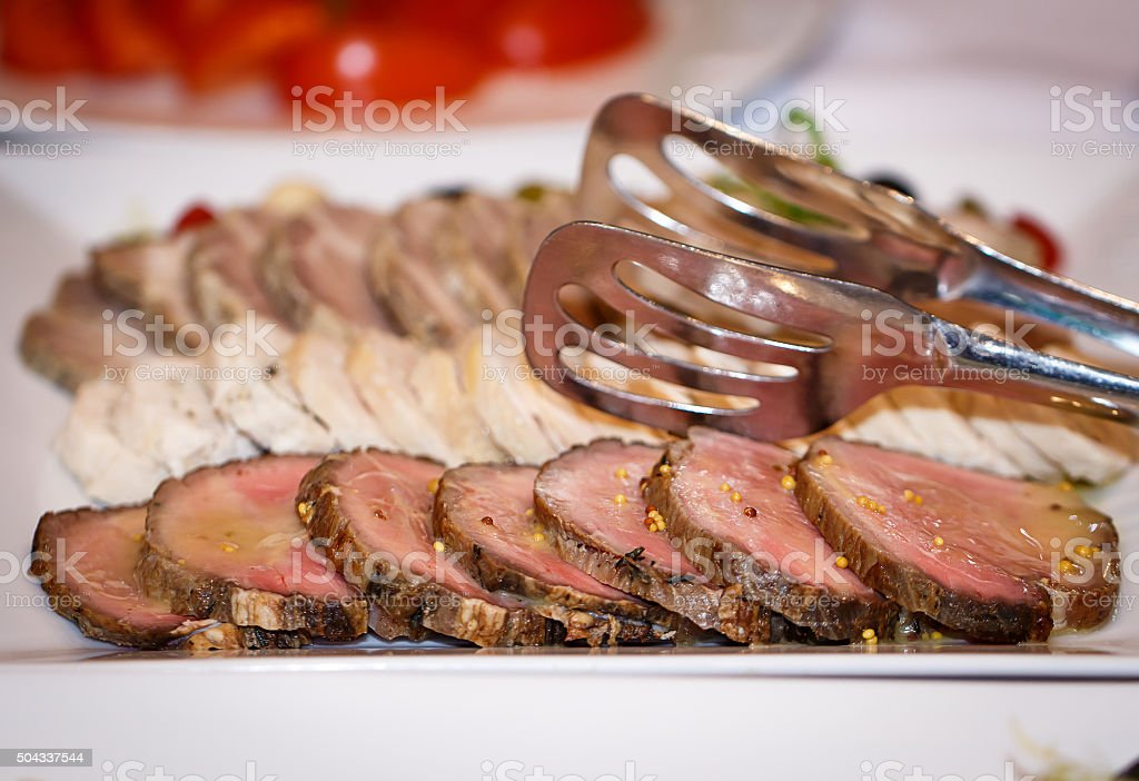 Fresh meat. Fillet medallions, steaks in a row. finished dish stock photo