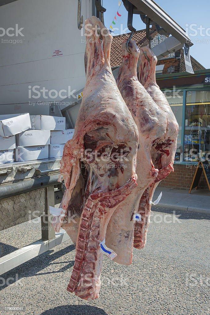 Fresh meat hanging being delivered. royalty-free stock photo
