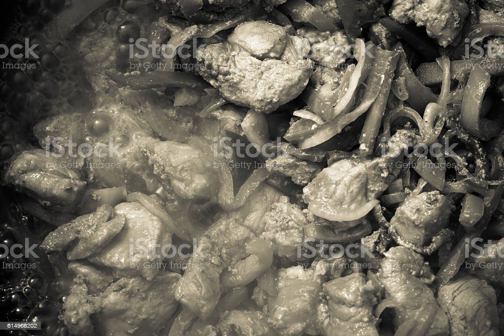 Fresh meat prepared on a pan with herbs and vegetables stock photo
