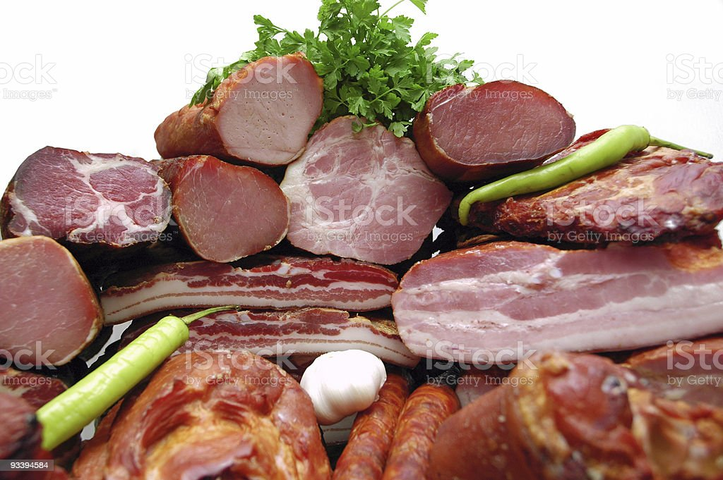 Fresh meat sliced into pieces along with celery royalty-free stock photo