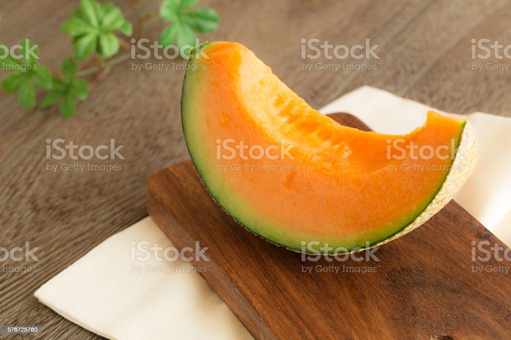 Fresh melon on a wooden board stock photo