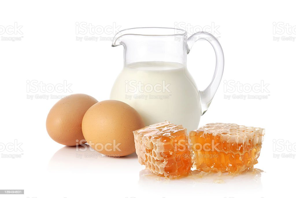 Fresh milk, two eggs and honey royalty-free stock photo