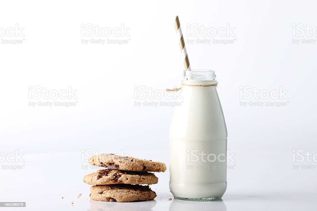 Fresh milk with drinking straw and cookies stock photo