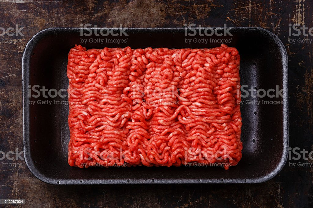 Fresh minced meat in plastic box stock photo