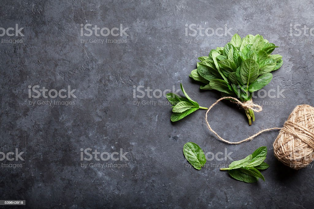 Fresh mint leaves herb on stone stock photo