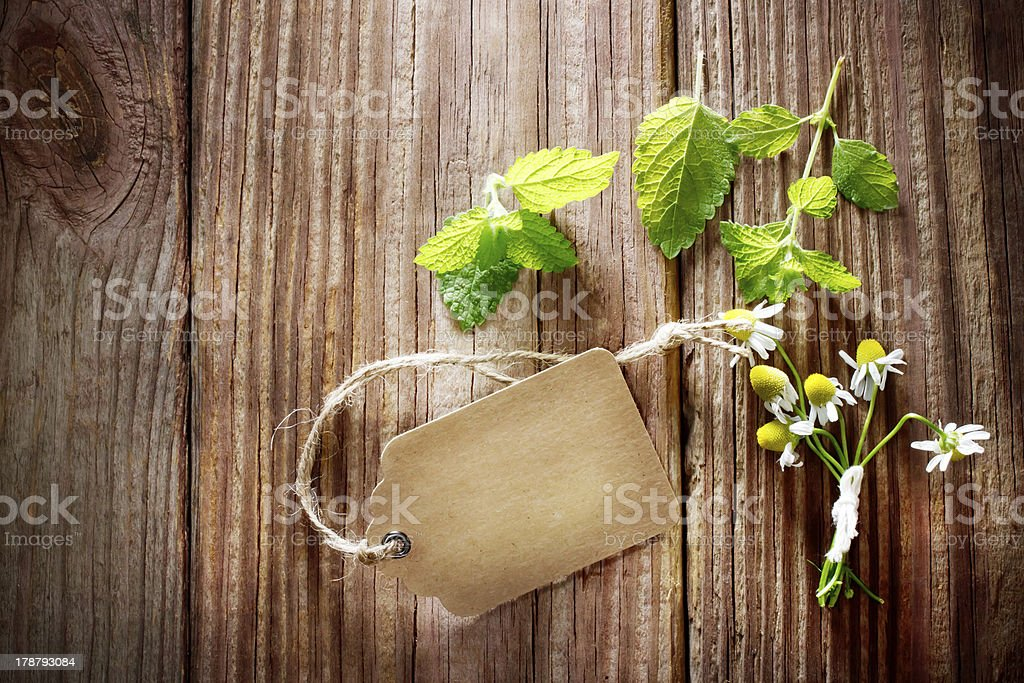 Fresh Mint on Rustic Table with Tag royalty-free stock photo
