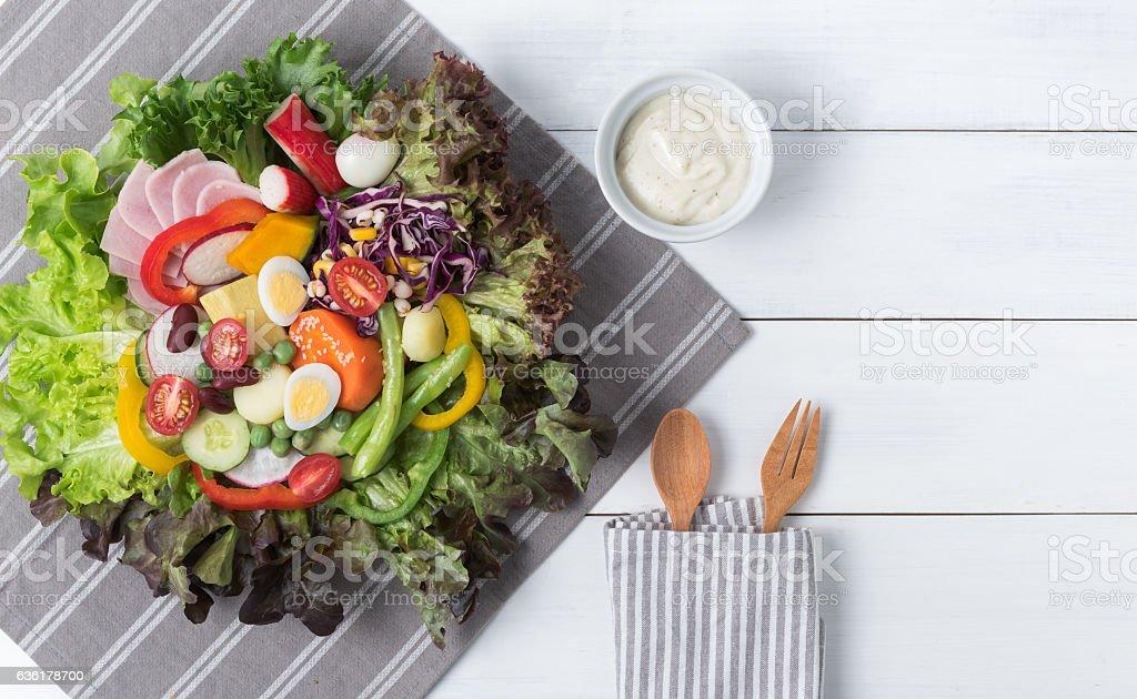 fresh mix vegetation salad on white wood background stock photo