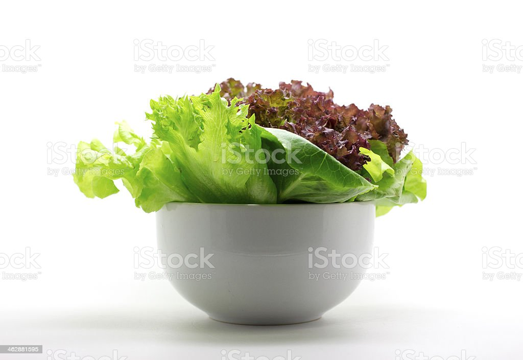 fresh mixed salad in a bowl stock photo
