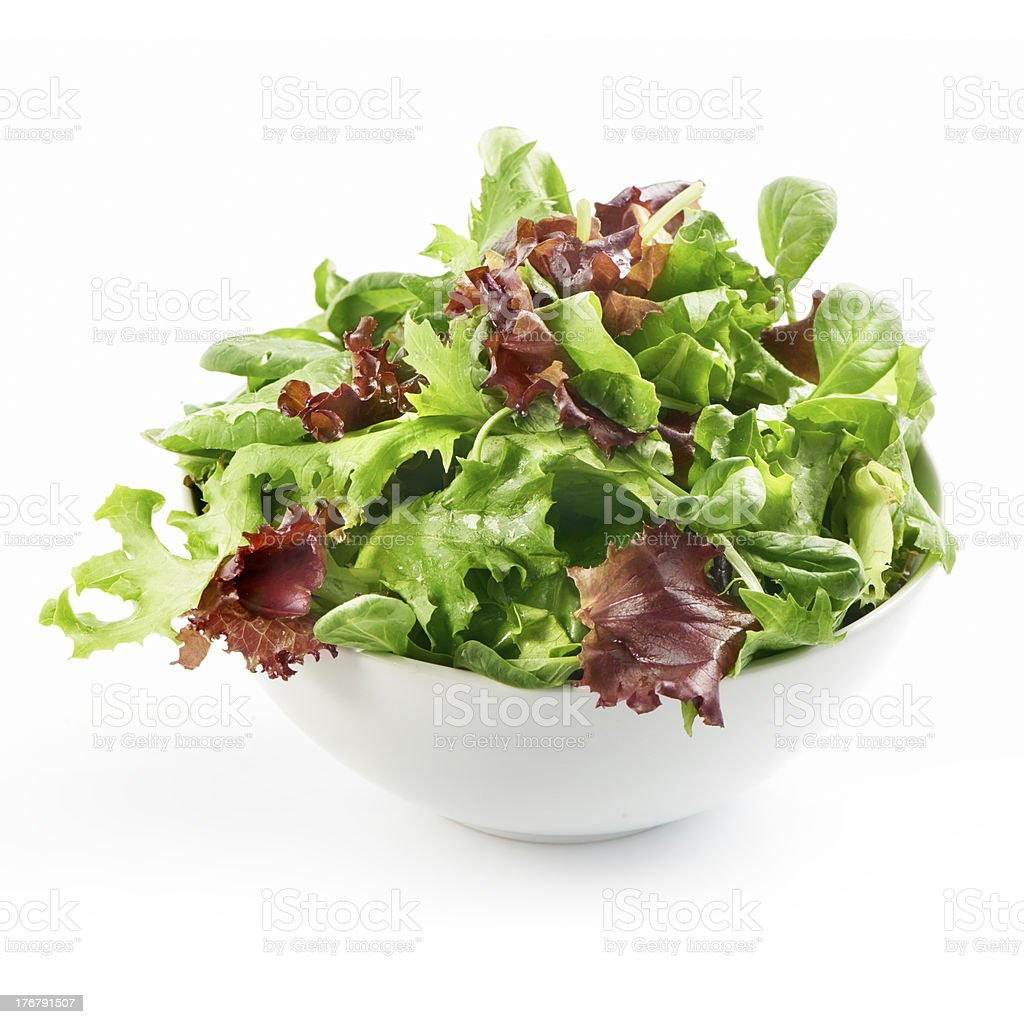 fresh mixed salad in a bowl side view stock photo