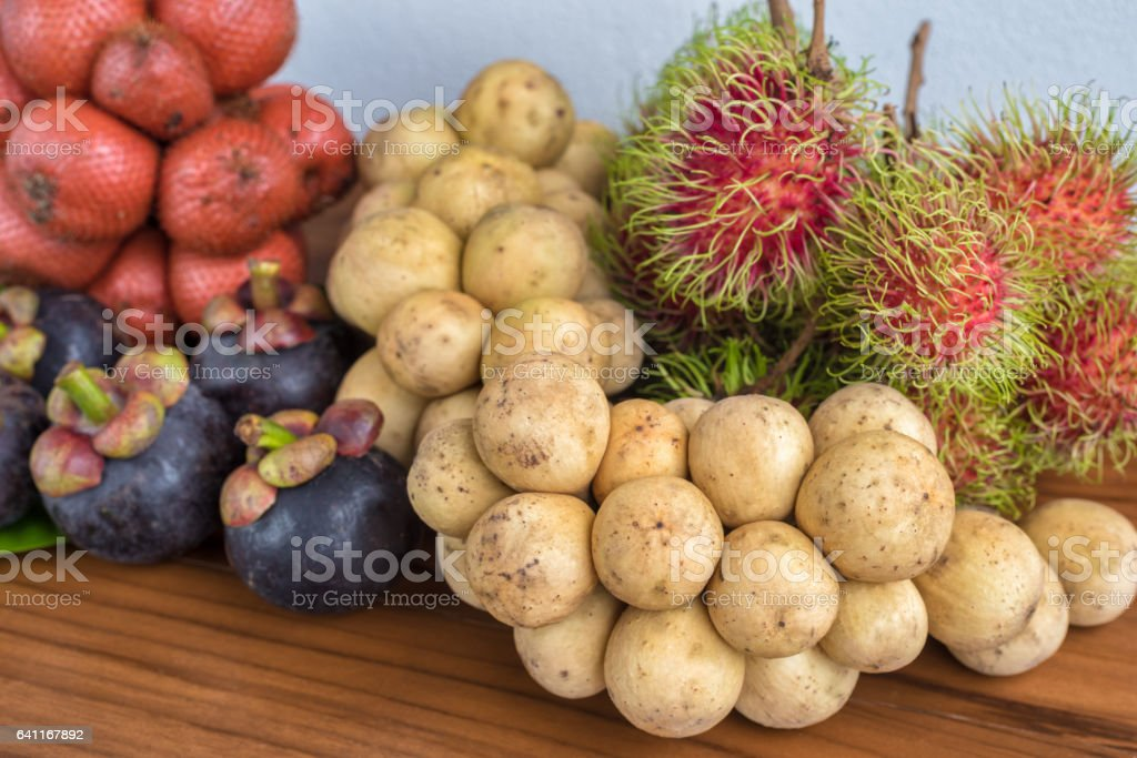 Fresh mixed thai fruits background stock photo