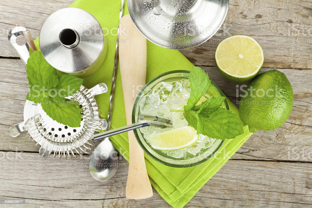 Fresh mojito cocktail and bar utensils stock photo